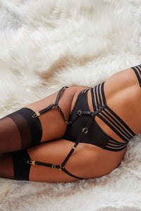 Stunning strappy bra and garter belt set