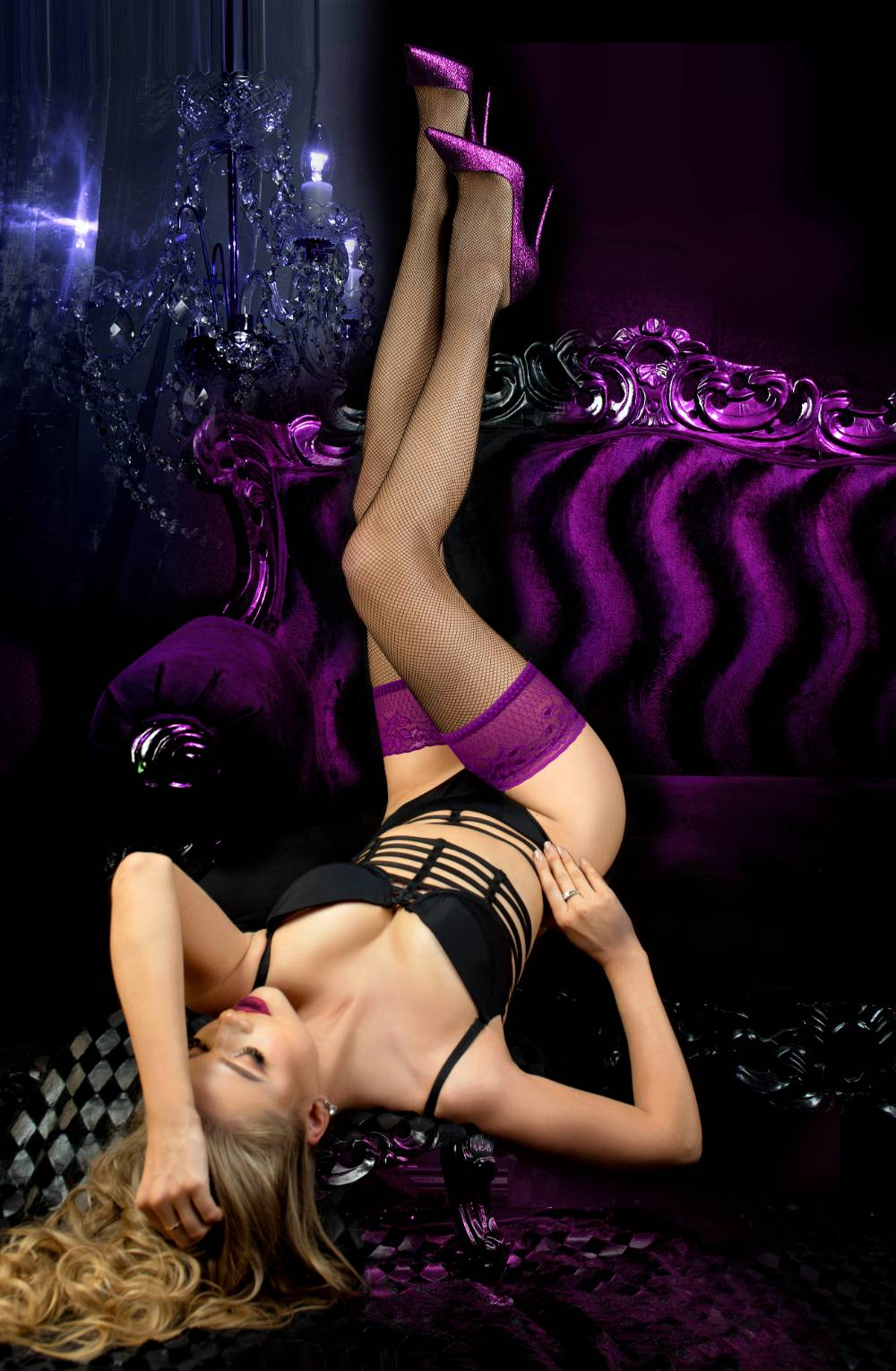Black fishnet stockings with the purple top