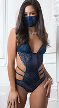 A provocative strappy bodysuit with lace mask