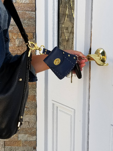 Demonstration of Keysie opening a door Keysie Breeze Black never lose your keys key finder key wallet new women women's accessory hanging key wallet