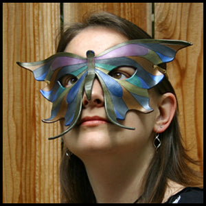 Erin of Eirewolf Creations, wearing one of her handmade leather butterfly masks.