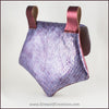 Handmade leather belt pouches in a medieval style with a scaled dragon skin texture, in purple or silver colors. By Erin Metcalf of Eirewolf Creations.
