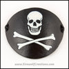 A handmade leather Jolly Roger eye patch, with hand carved and painted skull and bones, for a masquerade costume or pirate cosplay. By Erin Metcalf of Eirewolf Creations.
