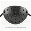 A handmade leather industrial style costume eye patch with 19 holes punched in it to allow some visibility, painted subtly sparkly black and backed with transparent black fabric. By Erin Metcalf of Eirewolf Creations.