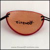 Handmade leather eye patches with a chunky Burtonesque spiral carved and painted red and black, for a masquerade costume or pirate cosplay. By Erin Metcalf of Eirewolf Creations.