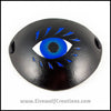 A bold graphic stylized blue eye with blue eyelashes carved and painted onto a handmade black leather eye patch, for a masquerade costume or pirate cosplay. By Erin Metcalf of Eirewolf Creations.