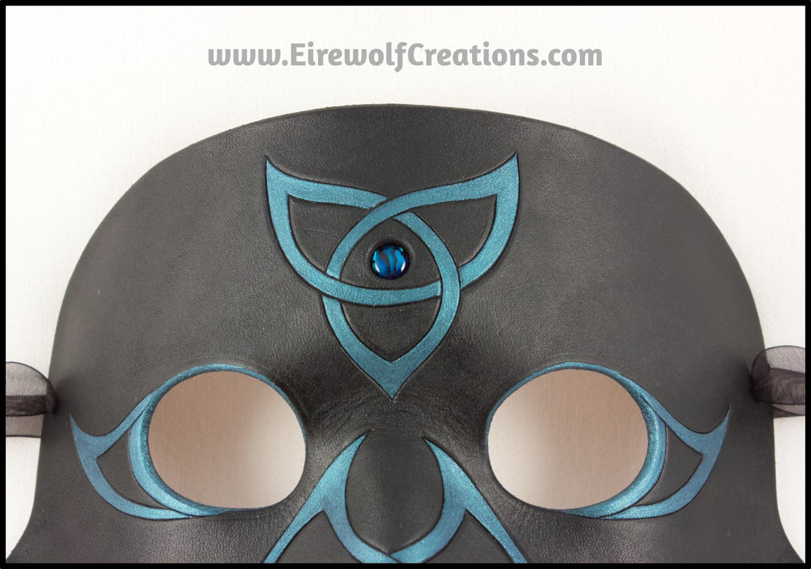 Celtic Raven mask with blue paua shell and iridescent teal Celtic knots, handmade leather masquerade mask, crow black bird, elegant Mardi Gras or Halloween costume