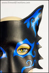 Spiral Wolf handmade leather masquerade mask with asymmetrical spiral designs, Mardi Gras or Halloween costume, blue or green on black