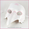 A handmade leather Albino Raven or White Crow mask for a masquerade costume, with carved and handpainted pale pink feather details. By Erin Metcalf of Eirewolf Creations.