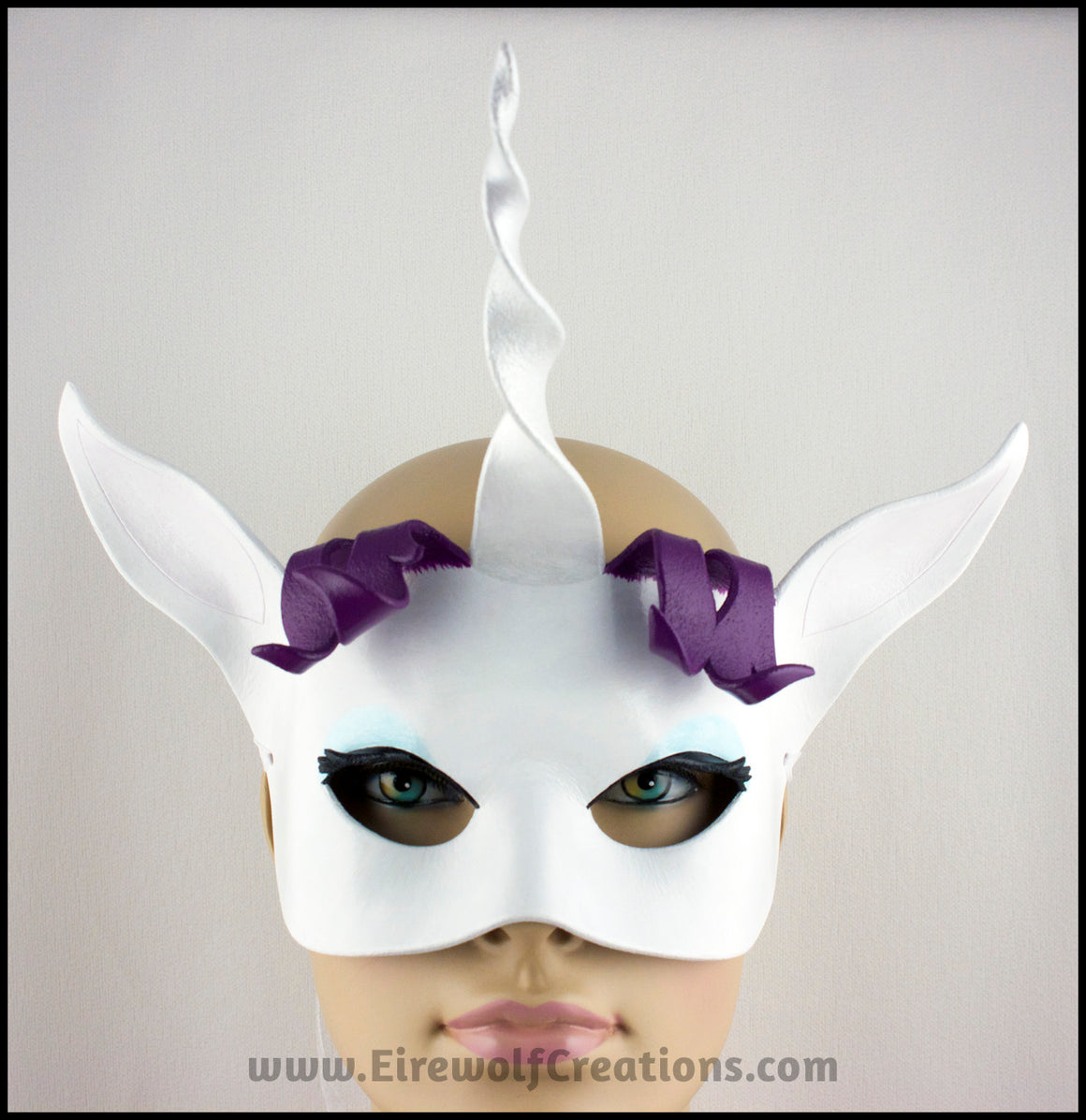 Cartoon Unicorn Rarity mask, handmade from leather for a masquerade costume or My Little Pony cosplay. By Erin Metcalf of Eirewolf Creations.