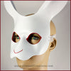 A handmade leather White Rabbit mask for a masquerade or Alice in Wonderland costume, painted white with red details around the eyes and nose. By Erin Metcalf of Eirewolf Creations.