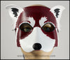 A handmade leather Red Panda masquerade mask with bold facial markings carved and painted on the leather. By Erin Metcalf of Eirewolf Creations.