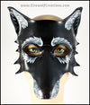 A grizzled Black Wolf mask for a masquerade costume, handmade from leather with carved and painted fur details. By Erin Metcalf of Eirewolf Creations.