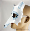 A handmade leather masquerade costume mask of a winter white wolf with silver fur details. By Erin Metcalf of Eirewolf Creations.
