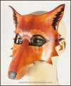 A handmade leather Wolf masquerade mask in rich tawny brown colors, with carved and painted fur details. By Erin Metcalf of Eirewolf Creations.