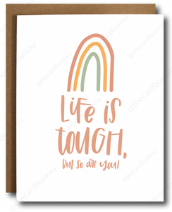 "red orange and green rainbow on white greeting card with pink text that reads ""life is tough, but so are you!"""