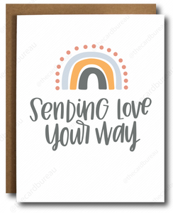"greeting card with white background and orange pink grey rainbow with grey text that reads ""Sending love your way""."