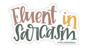 "Vinyl matte finish sticker that reads ""Fluent in Sarcasm"" in red, yellow and green cursive hand written font"
