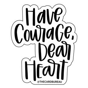 "Vinyl matte finish sticker that reads ""Have Courage Dear Heart"" in black writing"