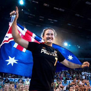 Tia-Clair Toomey holding the Australian flag. How I Became the Fittest Woman on Earth: My Story So Far by Tia-Clair Toomey. ISBN: 978-0-646-98727-9