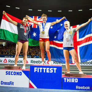 Tia-Clair Toomey on top of the CrossFit Games podium as the Fittest Woman On Earth holding the Australian flag. How I Became the Fittest Woman on Earth: My Story So Far by Tia-Clair Toomey. ISBN: 978-0-646-98727-9