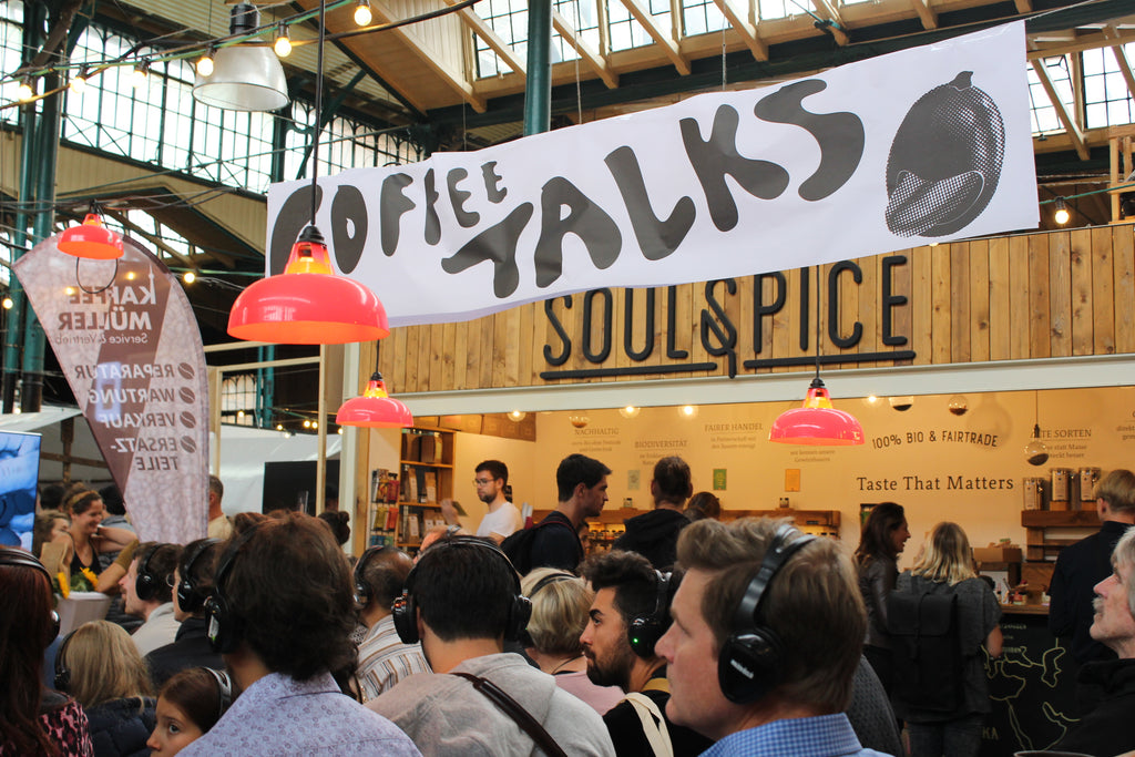 A sign with coffee talks across it at Berlin Coffee Festival