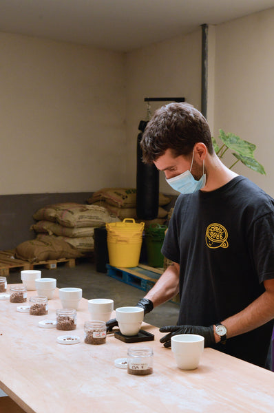 Cupping coffee at Hola Coffee