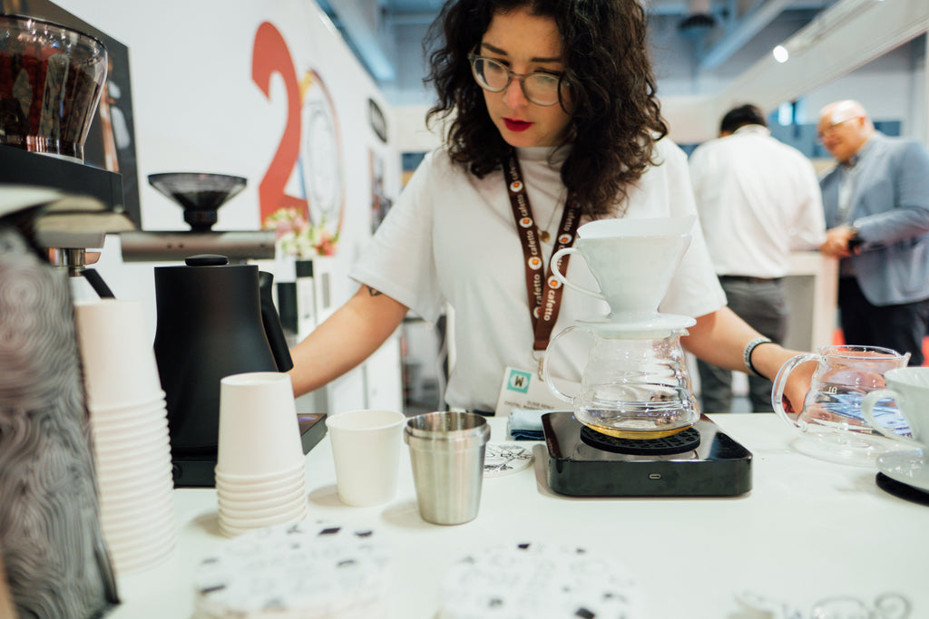 Susie brewing coffee at the Acaia Stand