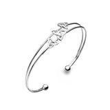 Photo of Sterling Silver trinity knots bangle
