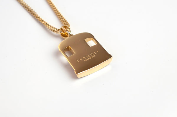 Gold Tram pendant and chain back view with SPRNGLL brand engraved