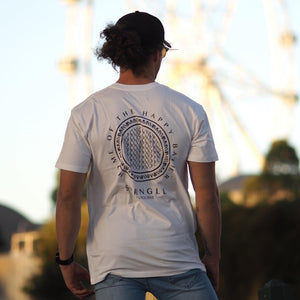 Man looking away while wearing a white SPRNGLL circle pattern Tee