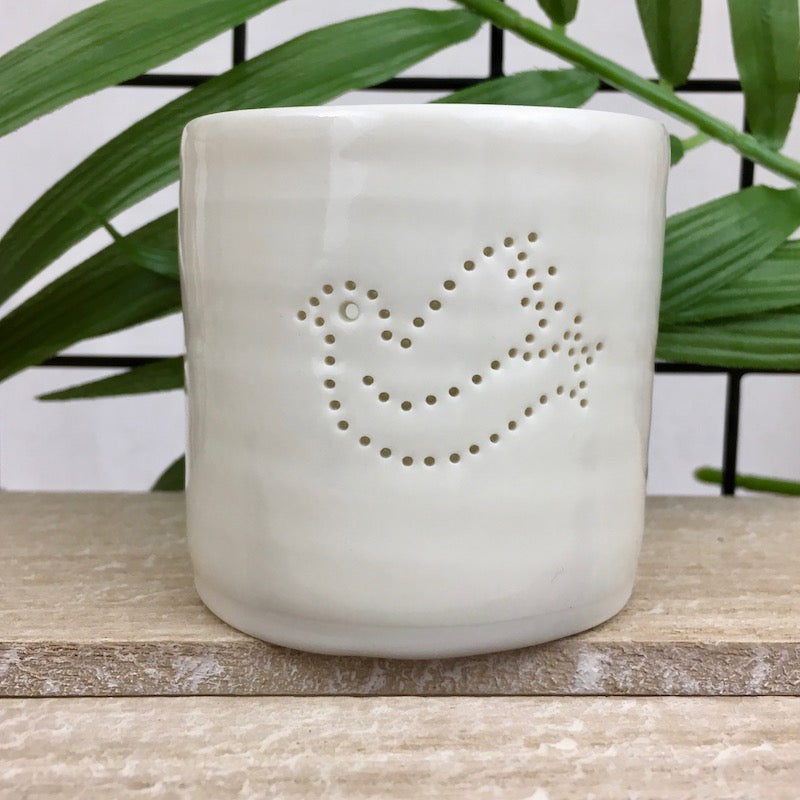 Ivory porcelain tea light holder with pinhole dove design