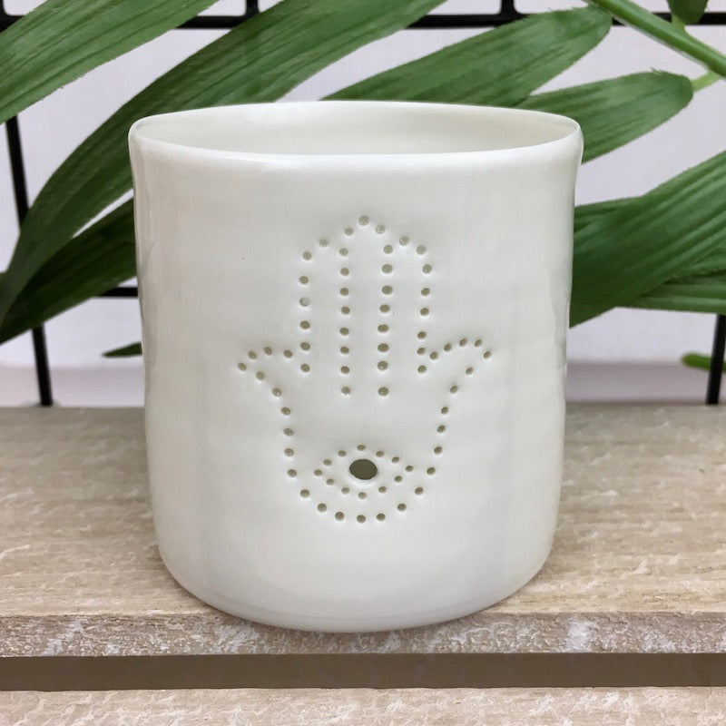 Ivory porcelain tea light holder with pinhole hamsa symbol design