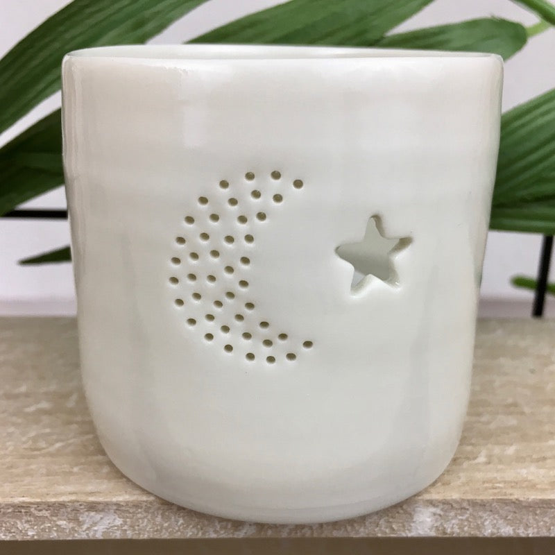 Ivory porcelain tea light holder with pinhole crescent moon and star design