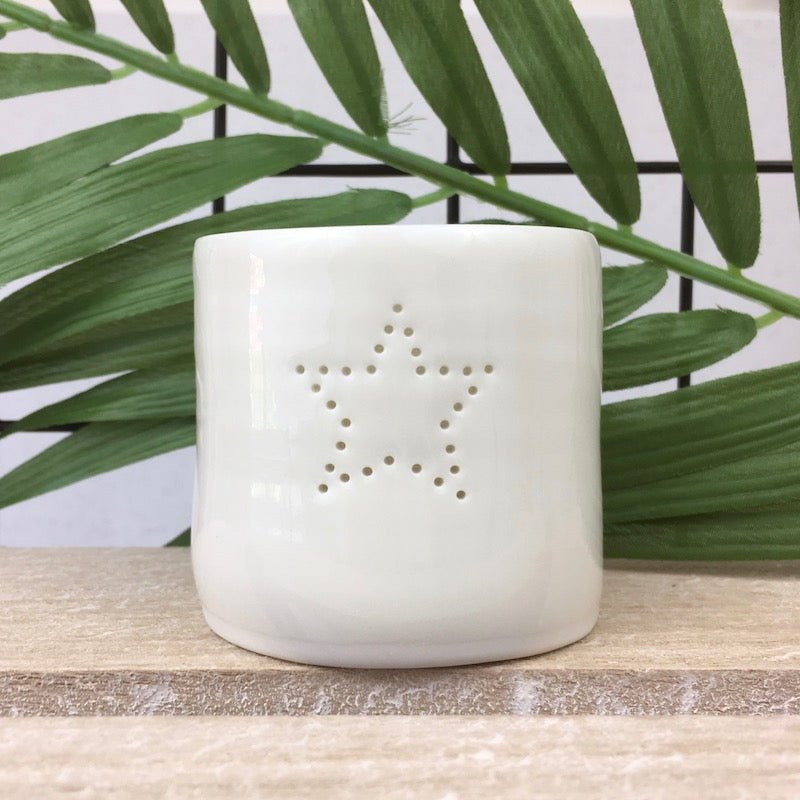 Ivory porcelain tea light holder with pinhole open star design