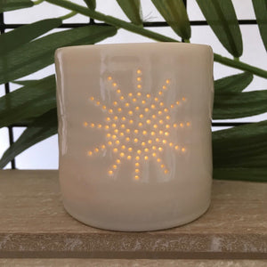 Ivory porcelain tea light holder with pinhole sunburst design