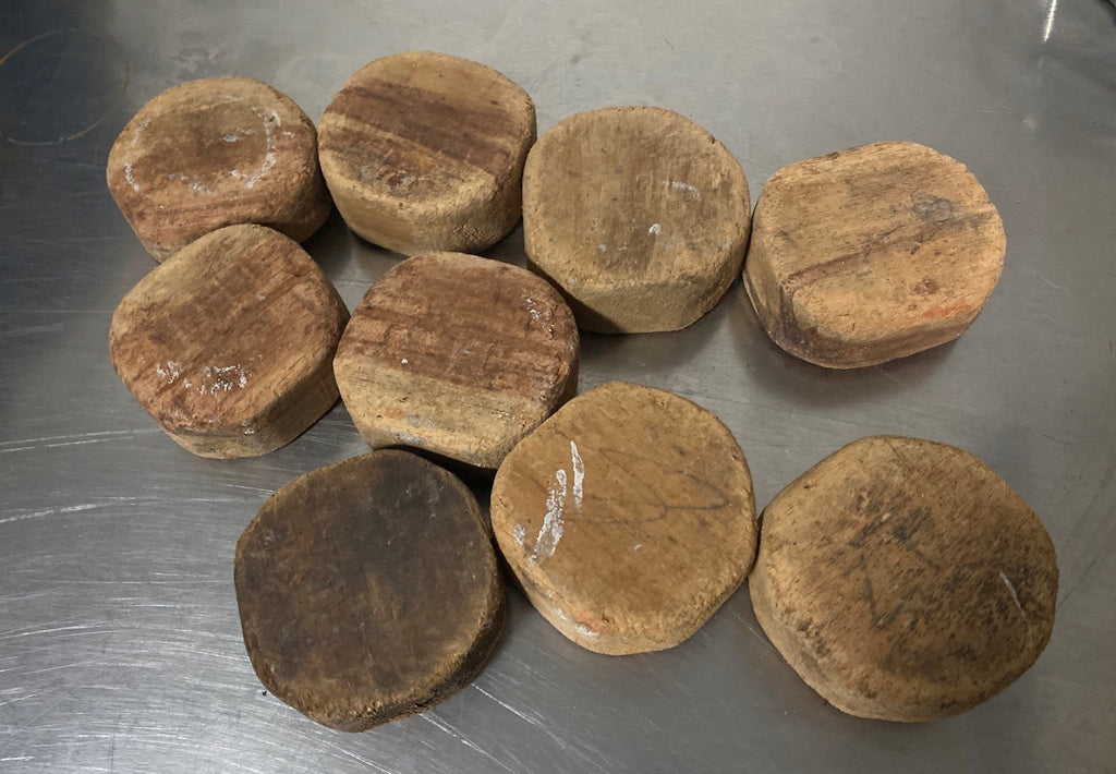 wooden hockey pucks hand carved