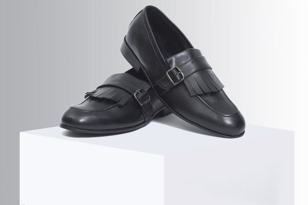 Black slip-ons with buckle - A Tailor's Tale