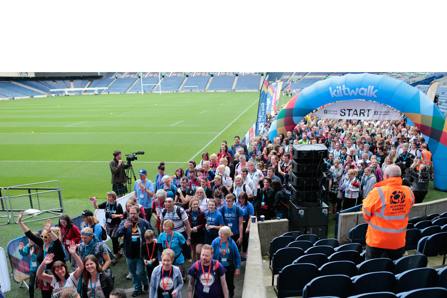 Crowds gather at the start of the Kiltwalk at Murrayfield