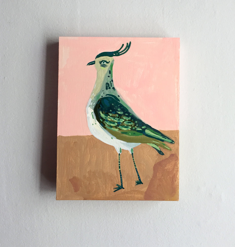 Green bird painting on a wood panel