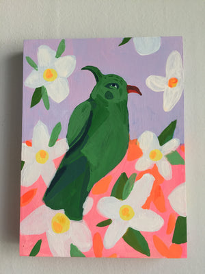 Green and neon bird painting on a wood panel