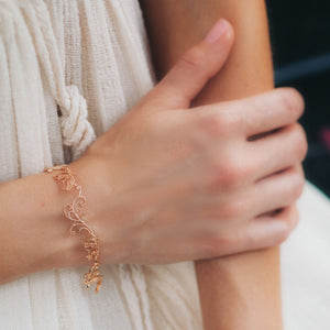 Model is wearing Rose-gold tone blush silver Baby B bracelet