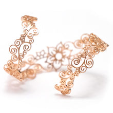 Back side of Flower arm cuff in rosegold tone blush silver