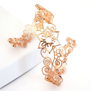 Bohemian inspired Flower arm cuff in rose-gold toned blush silver