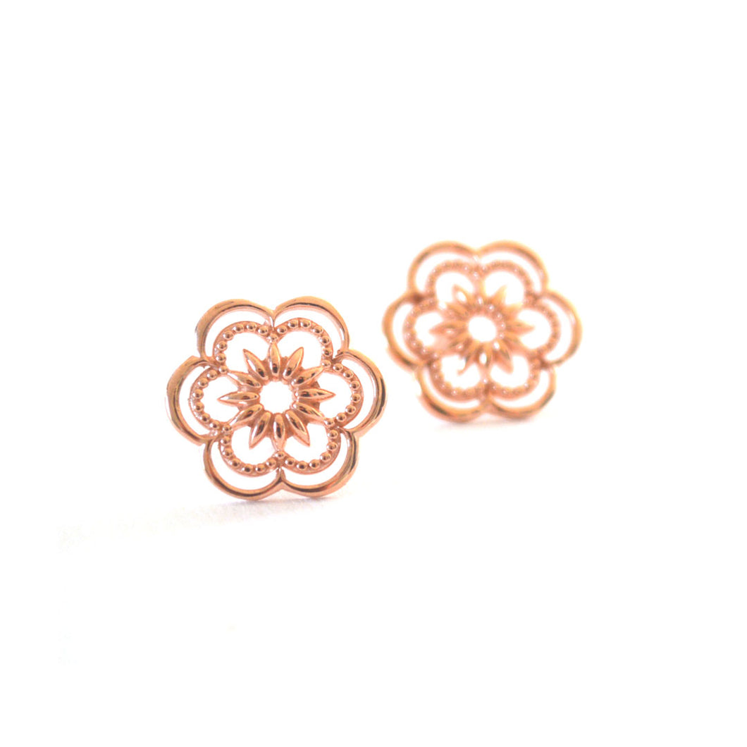 Origin stud earring with floral design in rose-gold toned blush silver, Floral stud earrings