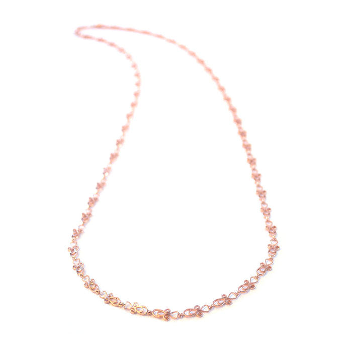 Star long chain necklace with swirling detail, rose-gold toned blush silver long chain necklace, simply long chain necklace
