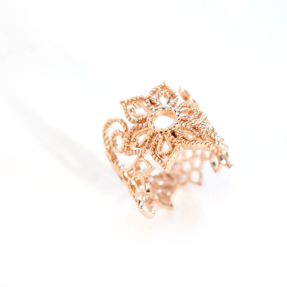 Flower Infinity Ring Edition 1 with swirl designs in rose-gold toned blush silver, Infinity ring