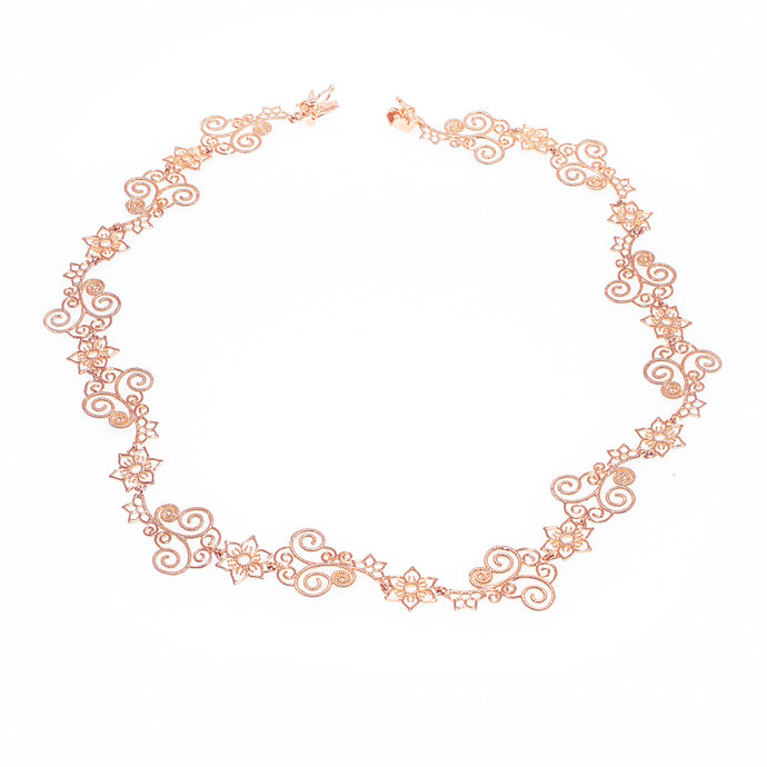 Flower Lady Necklace with flower and swirl details in rose-gold toned blush silver