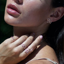 Model wearing the trillium collection stud earrings and cocktail ring.