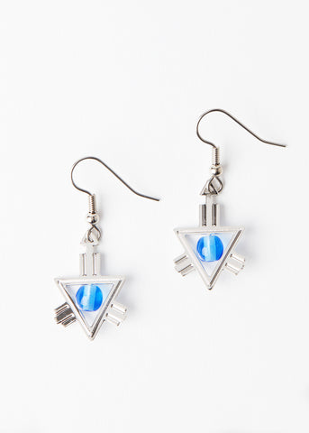 A pair of silver drop triangular earrings with a clear blue stone at the center.